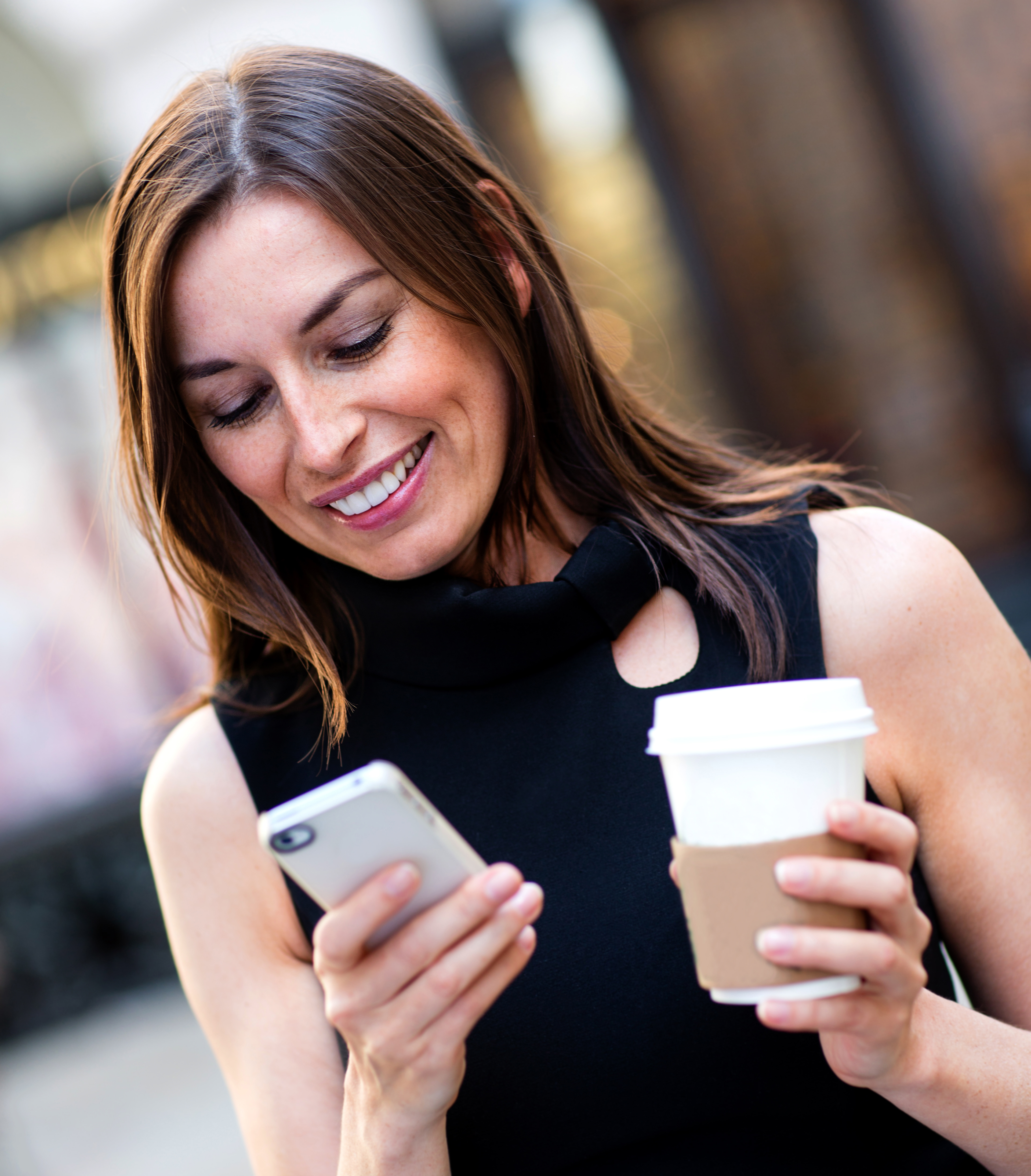 Busy business woman texting; on-the-go lifestyle and unified communications